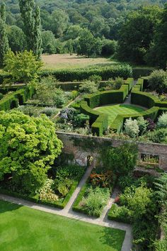 """Sissinghurst Castle Gardens, Kent. created by Vita Sackville West : largely defined by """"rooms within rooms"""" bordered by hedging and limited colour palette within each """"room""""."""