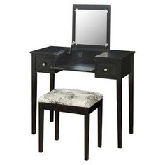 "Vanity table with a flip-top mirror and cushioned stool.    Product: Vanity table and stool Construction Material: Wood and fabric    Color: Black   Features:   Flip top mirror with safety stay hinge   Plush and padded stool   Pre-drilled wire management hole  Dimensions: 30"" H x 36"" W x 18"" D (vanity)"