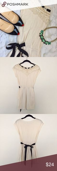 Urban Outfitters Kimchi Blue Cream Top Worn once, excellent condition! Gorgeous details! This cap sleeve top has lace, ribbons, pleats AND POCKETS! Purchased from Urban Outfitters, brand is Kimchi Blue. As seen on Shenae Grimes on 90210! Urban Outfitters Tops Tees - Short Sleeve