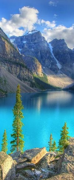 Moraine Lake in Alberta, Canada. Moraine Lake is a glacially-fed lake in Banff National Park, miles outside the Village of Lake Louise. It is in the Valley of the Ten Peaks, at an elevation of approximately feet. Lac Moraine, Moraine Lake, All Nature, Amazing Nature, Parc National De Banff, Banff National Parks, Places To Travel, Places To See, Travel Destinations