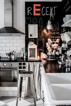 Great kitchen with black chalkboard wall