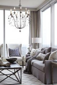 The living room in this suite at the Ritz-Carlton Residences in Buckhead uses texture and neutral colors to create a warm, inviting space. Contributed by Holly Smith (photo stylist) and Tim Moxley photography. HANDOUT PHOTO - NOT FOR RESALE