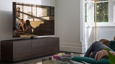 """The entry-level to Samsung's full backlit array series for the is anything but """"entry"""" - it's a sensation. Xbox, Tv Lineup, Microsoft, 65 Inch Tvs, Console, Wall Of Sound, Big Screen Tv, Samsung Tvs"""