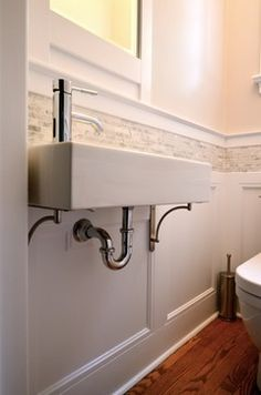 """Powder Room Renewal - Ikea sink with brackets outsourced from Lee Valley Tools and the tile is a carrera marble called Opus Strips, sold in 12""""X12"""" squares. The supplier is Ceragres (http://ceragres.ca/)."""