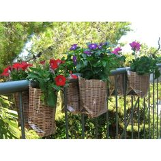 This gave me a great idea...With plenty of sticks in the yard I can use them to create baskets like these to hang off our deck.