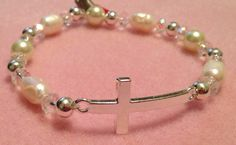 Silver sideways cross stretch bracelet with crystal and freshwater pearls $30