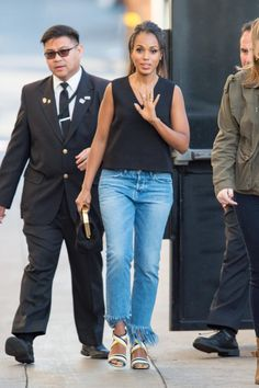 Kerry Washington wearing 3x1 Wm3 Crop Fringe Jeans in Stella, Kate Spade New York Sleeveless Shell in Black, Salvatore Ferragamo Gilli Sandals and Mansur Gavriel Volume Clutch in Black