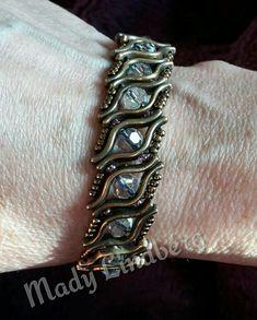 Beaded bracelet with lipbeads and round swarovski. My own design.