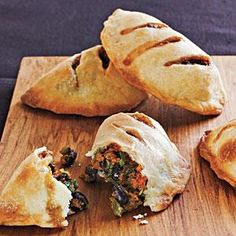Mild sweet potatoes and black beans take on smoky, spicy tastes from cumin and chiles. These pies are great served hot at a party; leftovers also make a tasty room-temperature snack.