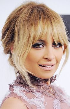 The ombré fringe and pale pink pout is a memorable Nicole Richie look.