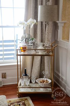 I've always wanted a bar cart. I think they are so chic! They have that James Bond, devil-may-care, joie de vivre attitude about them. They are cool and sophisticated and can be used for anything from hot chocolate bars to martini bars… And that's why I'm so happy they are making a huge comeback! You …