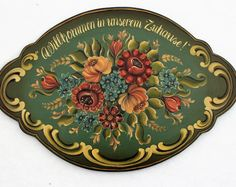 Beautiful Norwegian Rosemaling done in the Telemark Style on a 16 Double Beaded Nordic Plate.  Hand painted calligraphy done around the rim reading in Norwegian Velkommen til vart hjem, and accenting scrolls.  Background colors are Antiqued Telemark Green, Antiqued Burnt Orange, and faux wood bead. Onyx outer bead and back. Background colors are BM, with oil antiquing. Rosemaling is done with professional grade oil paints.  There are several coats of varnish and beeswax covering it for its…