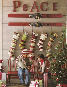 Love this whole wall from letters to skis to knit stockings to little chairs