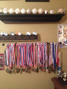 Curtain rod to display medals.  Thrift store shelves with washers glued on.   Then spray painted for golf ball and baseball displays.