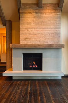concrete fireplace surround Fireplace Idea for kitchen/living/dining combo floor plan renovation - minus the upper ship-lap