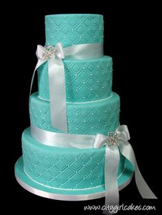 Tiffany blue wedding cake with ribbons and brooches.