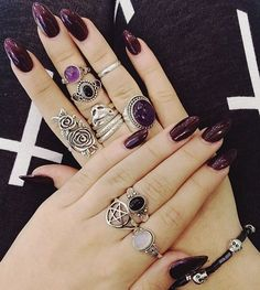 I wouldlove at least half of those rings. And the nail color is awesome festival Nails and Jewellery