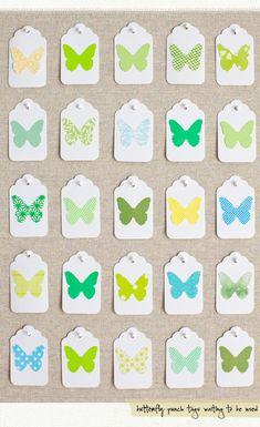 Craft-punch butterfly tags. Do this to display ink or must colors instead and display on linen pinboard
