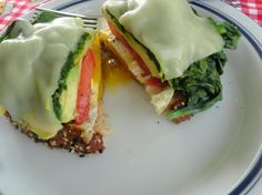 This breakfast sandwich is stacked with eggs, avocado, spinach, provolone cheese, tomato and multi-grain bread! YUM!
