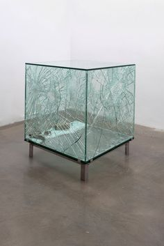 SARAH VAN SONSBEECK    ONE CUBIC METER OF BROKEN SILENCE, 2009  vandalized art object, brick, glass steel  104 cm x 104 cm x 104 cm