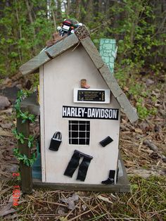 My dad has a leather shop in Raleigh NC named Custom Leather Products. I blinged out this bird house in his honor. His shop is a bit more modern than this, LOL but he loves it.