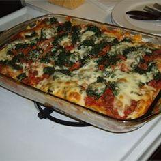 Rita's Spinach Casserole Allrecipes.com...Substitute spaghetti sauce for tomato sauce.  Consider adding italian seasoning, s/p and/or feta.
