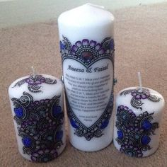 White candles with blue henna design