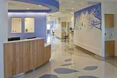 The nature theme of Nationwide Children's is carried throughout the hospital, with each floor given unique theming to help with wayfinding. Bedside nursing accommodations on. Medical Office Design, Modern Office Design, Modern Interior Design, Modern Offices, Healthcare Architecture, Healthcare Design, Hospital Design, Clinic Design, Treatment Rooms