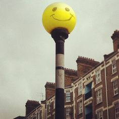 Flashing smiley faced zebra crossing light - street art that brings a smile!