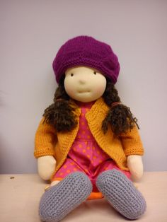 The doll in purple hat