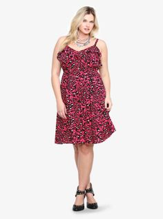 With a flirty ruffled neckline and a fierce leopard print, this pink challis dress is sure to give your wardrobe a playful shot of spring-ready style. The cinched empire waist ties in front.