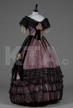 The Mary Holden Illingworth Collection. A fine pink taffeta and black tulle ball gown, late 1850s
