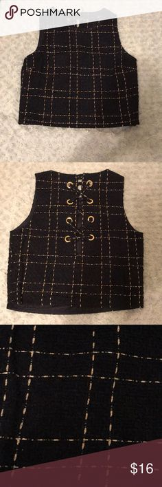 Tweed lace up crop top Navy tweed with gold running through. Lace up back with gold grommets. Zipper on one side and button at the back of the top to help put on. Forever 21 Tops Crop Tops