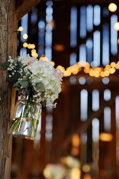 Love the simple white flowers hanging in the jar
