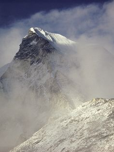 1953 - The sunlight glints off the peak of Everest which is obscured by cloud. © RGS-IBG/Alfred Gregory