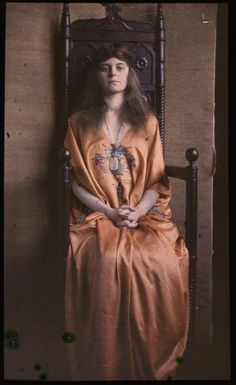 Woman in silk gown, sitting in wooden throne by unidentified c. 1915 autochrome