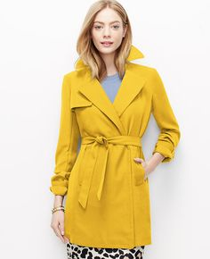 """Tailored touches and a relaxed silhouette make our versatile trench an all-season staple. Stand collar with exposed snap and latch. Long sleeves with tabs and exposed snaps. Double breasted exposed snap front. Self tie belt. Front storm flap. Vertical front welt pockets. 33 1/2"""" long."""