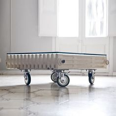 Bonba studio designed the Radiator Table where they upcycled a discarded cast iron radiator and added a glass top and wheels.