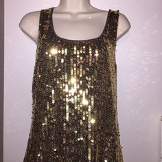Beautiful NWOT Gold Sequin Tank Top Brand new, never worn gold sequin tank top. I listed as NWOT because paper tag is off but you can see in photo that the plastic tag holder is still on! Front is gold sequin, back is chocolate brown fabric. Please check out my other items because I offer bundle discount!   Tops Tank Tops