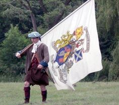 Reenactor of Jacobite with Jacobite Banner