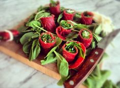 Bresaola wrapped in rucola and cheese.