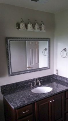 Stunning bathroom remodel includes granite countertop, ceramic floor