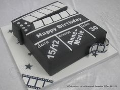 Clapper Board Cake. Lights. Camera. Action.  Novelty film set clapper board birthday cake shaped just like the real thing. Great for career minded and film industry professionals or as a centre piece to grace any Hollywood themed party. A gala night for the stars