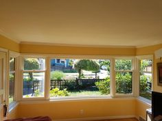 Full frame replacement on 20 year old vinyl. Four energy efficient Double-Hung Cottage Style windows surrounding 1 large picture window gives this 1940's home in Loyal Heights quite the charming view.
