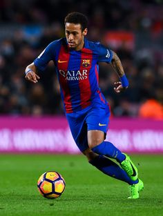 Neymar Jr. of FC Barcelona runs with the ball during the La Liga match between FC Barcelona and Real Sporting de Gijon at Camp Nou stadium on March 1, 2017 in Barcelona, Catalonia.