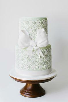 Mint and white wedding cake with white bow by The Cake That Ate Paris.