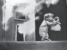 Harry Whittier Frees (1879–1953) was an American photographer who created novelty postcards and children's books based on his photographs of LIVE animals. He dressed the animals and posed them in human situations with props, often with captions; these can be seen as progenitors of modern LOLcats.