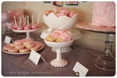 pink dipped rice crispy treats and coconut cake w/pink icying and strawberry display