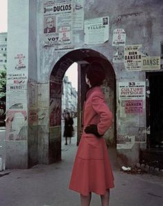 Travel Photograph - A Model Wearing A Red Coat On A Street In Paris by John Rawlings