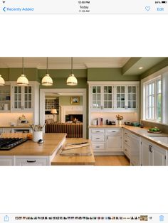 Swiss Coffee Kitchen w/ white appliances w/ avocado green walls